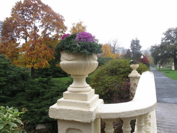 Urns on the upper bridge decorated for fall at the Halifax Public Gardens